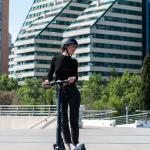 okai-es200-escooter-woman-riding-city.jpeg